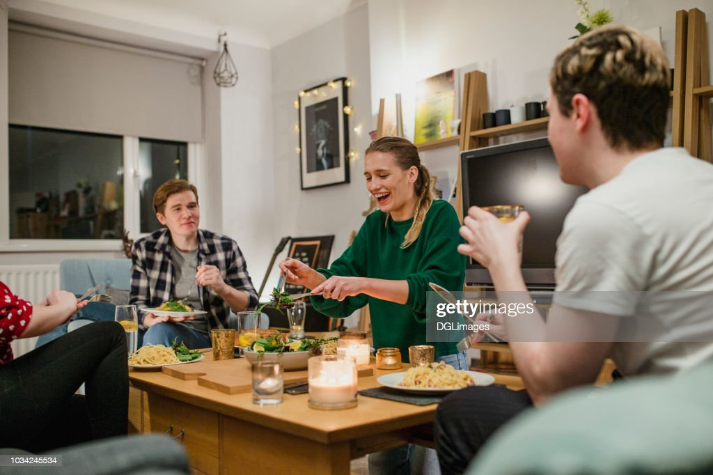 Young Couples Having Dinner at Home : Stock Photo