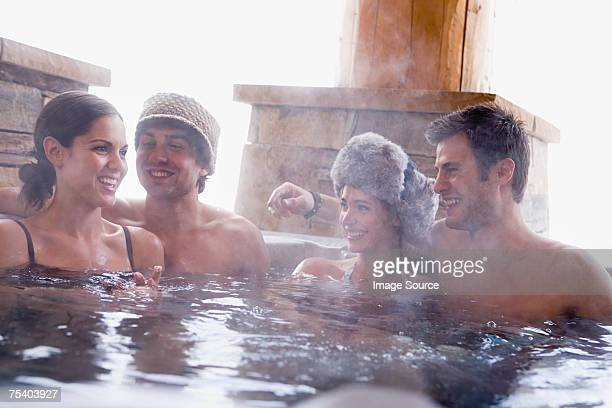 Young couples in a hot tub
