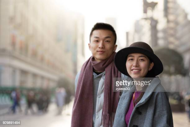 young couples in shanghai nanjing road pedestrian street,china - east asia. - china east asia stock pictures, royalty-free photos & images