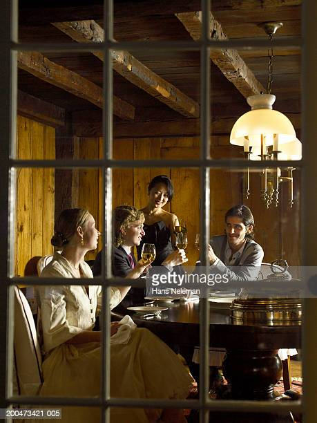 Young couples talking around table at party