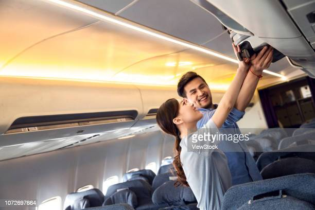 young couples to travel by plane - luggage rack stock photos and pictures