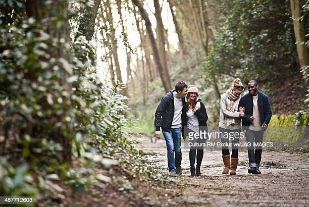 Young couples walking through forest