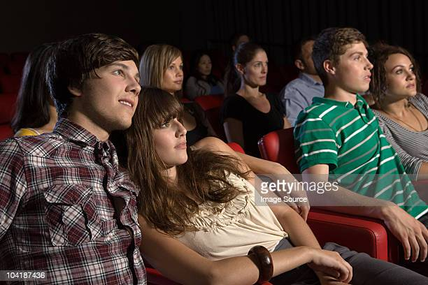 Young couples watching a movie