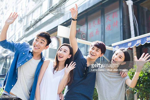 Young couples waving hands