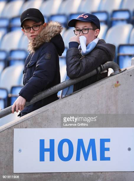 Young Coventry City fans look on prior to The Emirates FA Cup Third Round match between Coventry City and Stoke City at Ricoh Arena on January 6 2018...