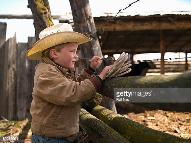 Young cowboy on ranch