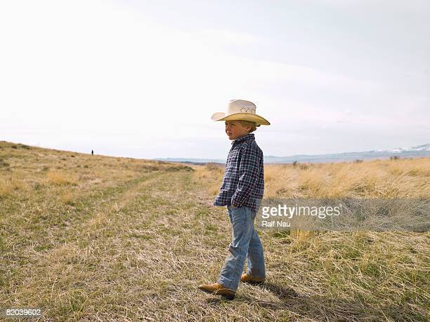 young cowboy on the prairie - one boy only stock pictures, royalty-free photos & images