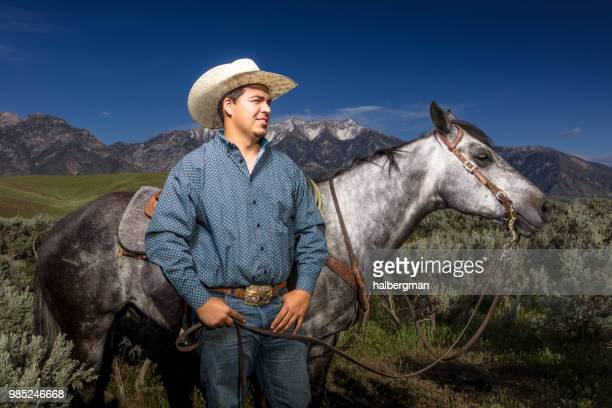 Young Cowboy Posing with Horse in Profile