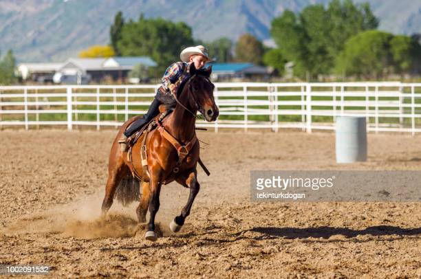 young cowboy riding horse  at rodeo paddock arena in nephi  salt lake city slc utah usa - spanish fork utah stock pictures, royalty-free photos & images