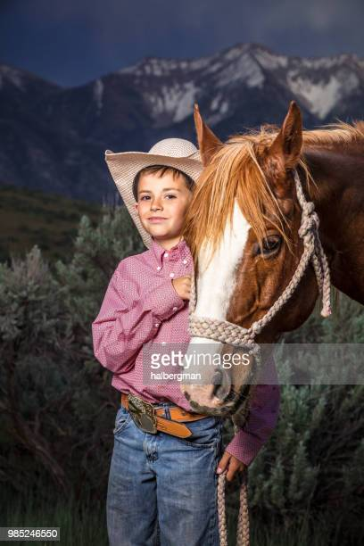 Young Cowboy Smiling With Horse