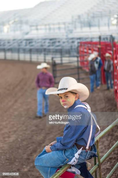 young cowboy waiting at rodeo paddock