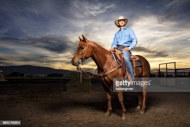 Young Cowboy Waiting on Horseback in Stable Yard