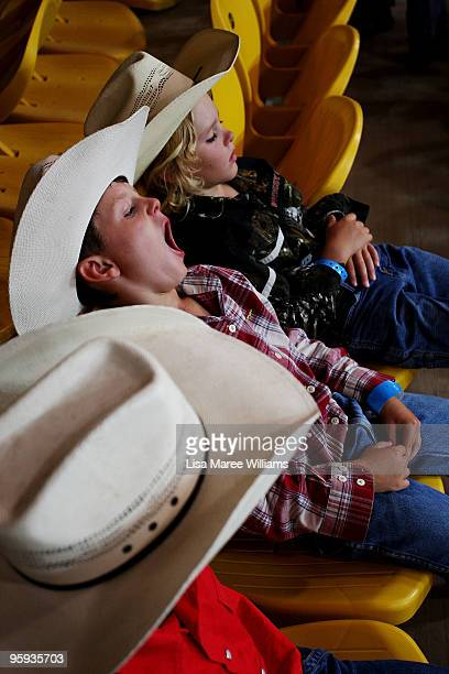 A young cowboy yawns during the ABCRA National Rodeo Finals on January 22 2010 in Tamworth Australia The National Rodeo is held in conjunction with...