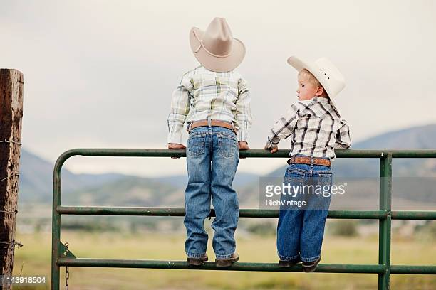 young cowboys - cowboy hat stock pictures, royalty-free photos & images