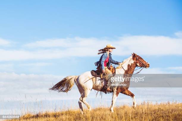 young cowgirl on horseback - istock photo stock pictures, royalty-free photos & images