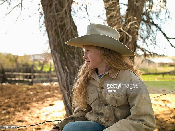 Young cowgirl outdoors