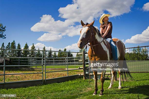 Young Cowgirl Sitting On Her Horse