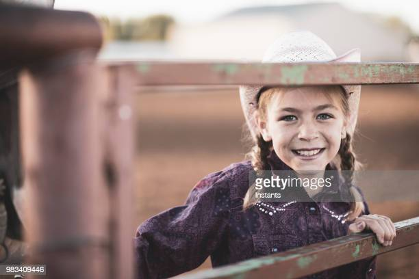 young cowgirl with her horse. - cowgirl hairstyles stock photos and pictures