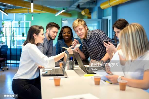 young coworkers in modern office - finanza ed economia foto e immagini stock