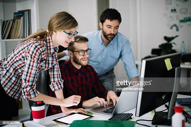 Young co-workers motivated for new project