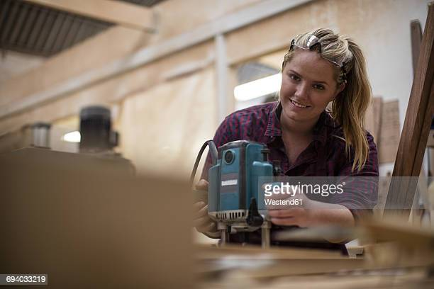 Young craftswoman working in woodwork