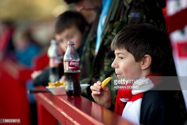 A young Crawley Town supporter eats chips ahead of the FA Cup third round against Bristol City at Broadfield Stadium in Crawley on January 7 2012...