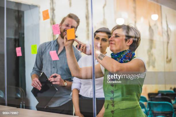 young creative business people meeting at office - reflection stock pictures, royalty-free photos & images