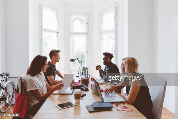 Young creative people co-working in startup office