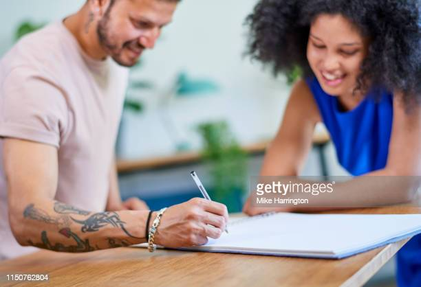 young creative team working in contemporary sustainable office environment brainstorming. - sleeveless dress stock pictures, royalty-free photos & images