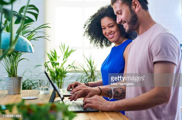 young creative team working in contemporary sustainable office environment - sleeveless dress stock pictures, royalty-free photos & images