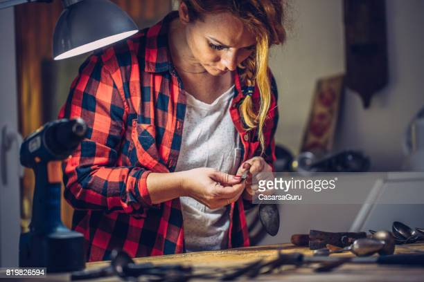 Young Creative Woman Working Late in Dark Room