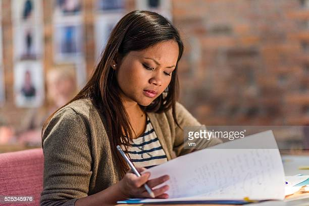 Young creative writer reviewing her writings