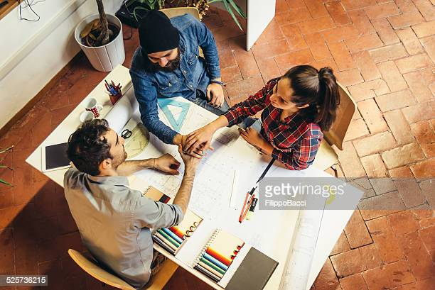 young creatives team working together - real estate office stock photos and pictures