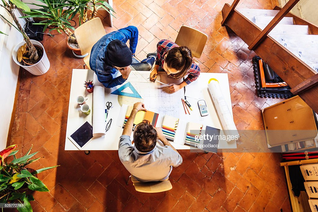 Young Creatives Team Working Together : Stock Photo