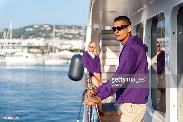 Young crew members on luxury yacht
