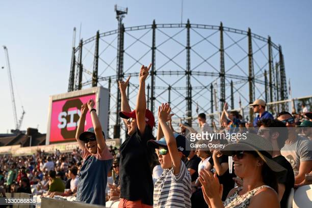 Young cricket fans cheer during the Hundred match between Oval Invincibles and Manchester Originals at The Kia Oval on July 22, 2021 in London,...