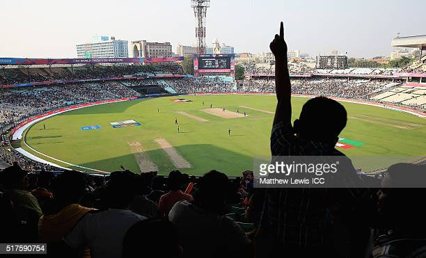 A young cricket supporter watches on during the ICC World Twenty20 India 2016 match between Bangladesh and New Zealand at Eden Gardens on March 26...