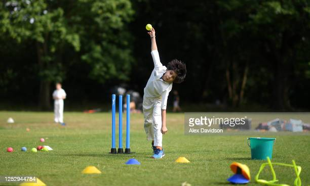 Young cricketer in action during a juniors training session at Roehampton Cricket Club on June 27, 2020 in London, England. Roehampton Cricket Club...