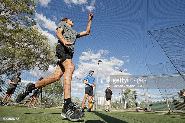 Young cricketers are given a fast bowling clinc by Australian player Pat Cummins during day 4 of the National Indigenous Cricket Championships on...