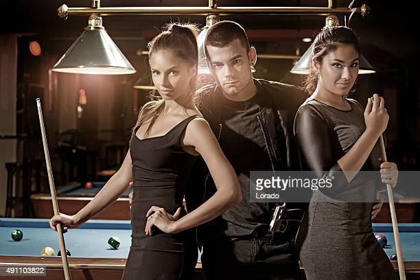 young criminal at pool hall with two women
