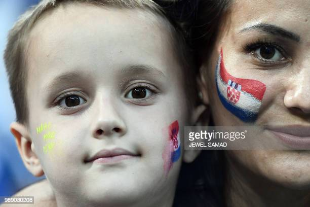 TOPSHOT A young Croatia fan poses with his mom before the Russia 2018 World Cup round of 16 football match between Croatia and Denmark at the Nizhny...