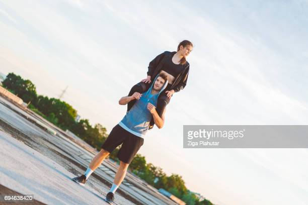 Young Crossfitter Couple Exercise outdoors