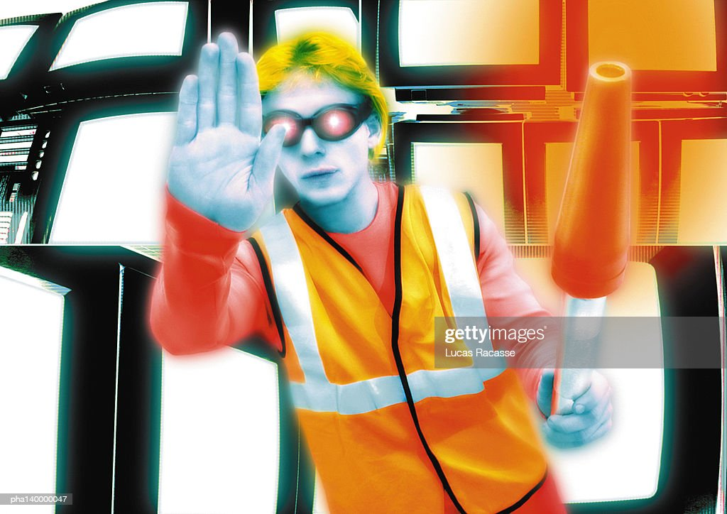 Young crossing guard standing in front of monitors, hand out toward camera, digital composite. : Stockfoto