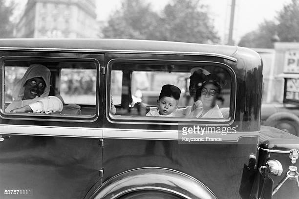 Young crown Prince of Morocco Moulay Hassan, arrives by train in Marseille, leaves the Station of Lyon accompagnied by his nurse on August 5, 1931 in...