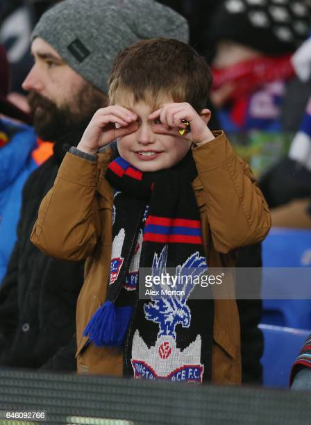 A young Crystal alace fan taunts Middlesbrough fans during the Premier League match between Crystal Palace and Middlesbrough at Selhurst Park on...
