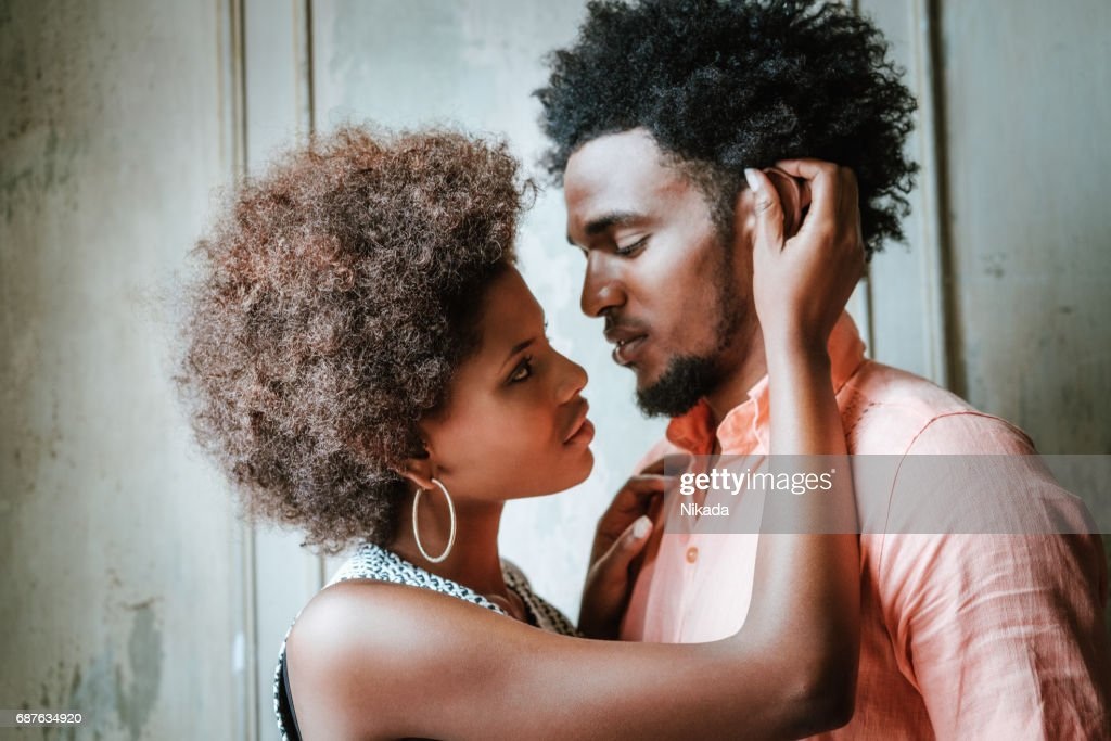 Young cuban couple standing at doorway : Stock Photo