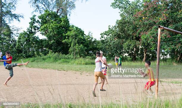 Young Cuban people playing soccer in an abandoned field The practice of sports is widespread in the island due to high educational levels so youth...