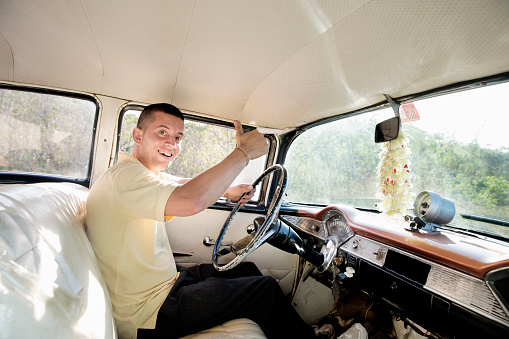 Young Cuban taxi driver - gettyimageskorea