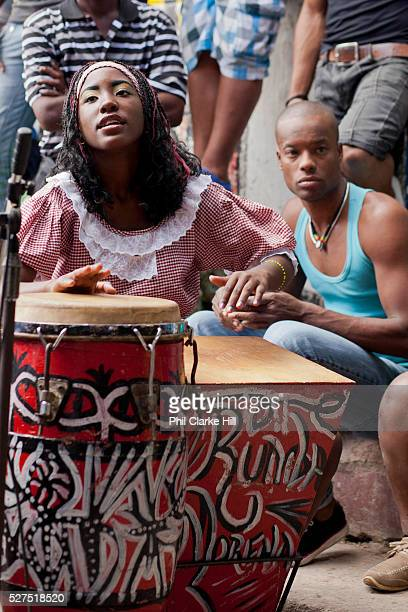 Young Cuban woman playing the congoes Callejon de Hamel a street art project in old Havana which has a Rumba show on a Sunday afternoon and has...