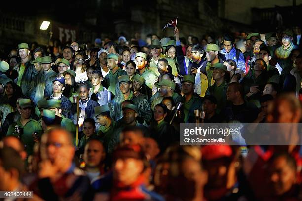 Young Cubans in military uniforms prepare for the start of the March of the Torches on the steps of the University of Havana on January 27 2015 in...